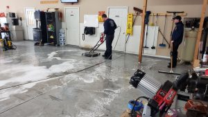 Power scrubing bay floor