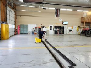 Cleaning bay floor drains