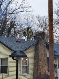 crews work on chimney fire