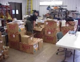 Scott Certified Technician Todd Schindler inventories equipment shipped for the FEMA Grant Project.